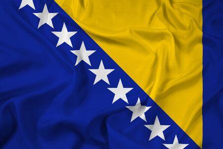 herzegovina: Waving Flag of Bosnia and Herzegovina Stock Photo