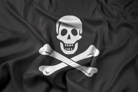 jolly roger: Waving The traditional Jolly Roger of piracy Flag Stock Photo