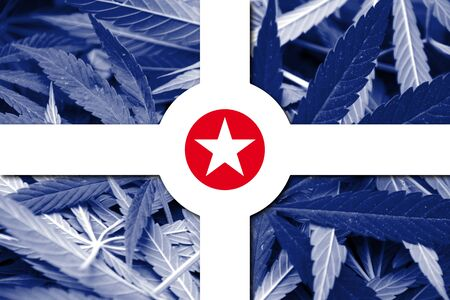 indianapolis: Flag of Indianapolis, Indiana, on cannabis background Stock Photo