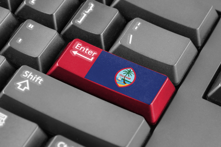 unincorporated: Enter button with Flag of Guam Stock Photo