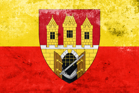 escutcheon: Flag of Prague with Coat of Arms (Escutcheon only), Czechia, with a vintage and old look Stock Photo