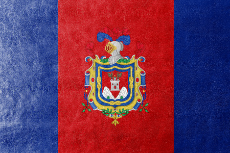 polity: Flag of Quito, Ecuador, painted on leather texture Stock Photo