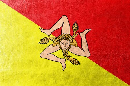 Flag of Sicily Region, Italy, painted on leather texture Stock Photo