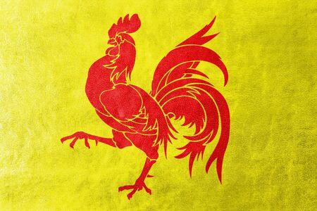 administrativo: Bandera de la Región Valona (Valonia), Bélgica, pintado sobre la textura de cuero Foto de archivo