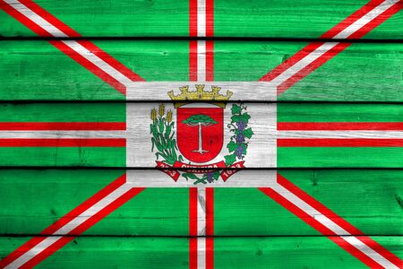 polity: Flag of Curitiba, Parana, Brazil, painted on old wood plank background Stock Photo