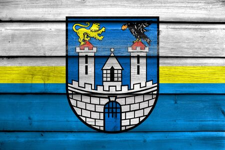 czestochowa: Flag of Czestochowa with Coat of Arms, Poland, painted on old wood plank background Stock Photo