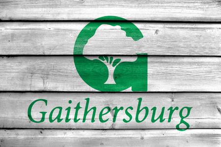 Flag of Gaithersburg, Maryland, USA, painted on old wood plank background Stock Photo