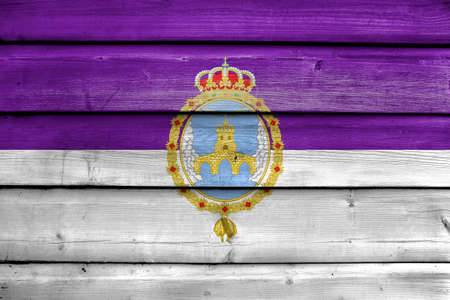 loja: Flag of Loja, Spain, painted on old wood plank background