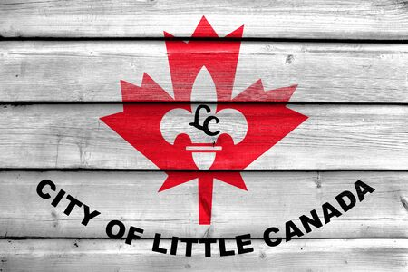 Flag of Little Canada, Minnesota, USA, painted on old wood plank background Stock Photo