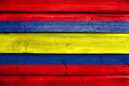 Flag of Loja, capital of Loja Province, Ecuador, painted on old wood plank background