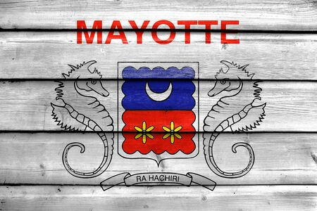 mayotte: Flag of Mayotte, France, painted on old wood plank background