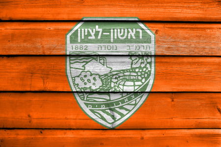 jewish community: Flag of Rishon LeZion, Israel, painted on old wood plank background