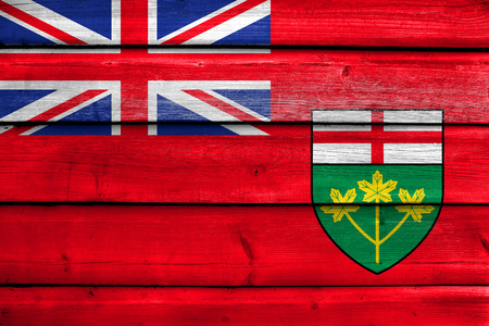 polity: Flag of Ontario Province, Canada, painted on old wood plank background Stock Photo