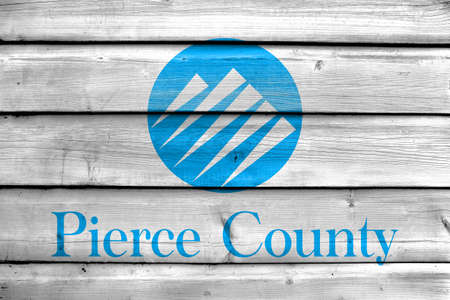 pierce: Flag of Pierce County, Washington, USA, painted on old wood plank background