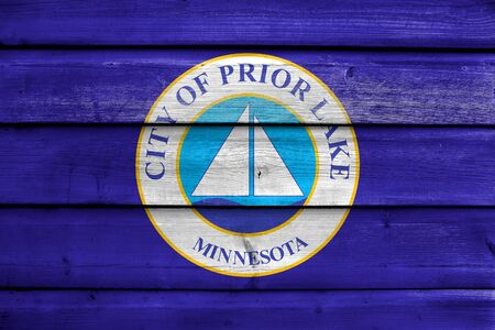 prior lake: Flag of Prior Lake, Minnesota, USA, painted on old wood plank background