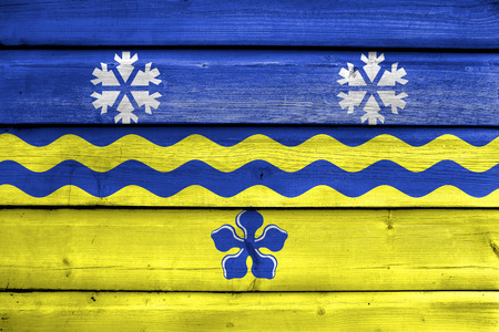 polity: Flag of Prince George, British Columbia, Canada, painted on old wood plank background