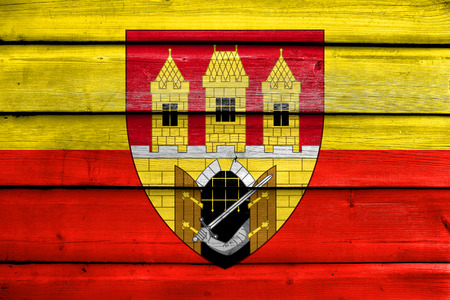 escutcheon: Flag of Prague with Coat of Arms (Escutcheon only), Czechia, painted on old wood plank background