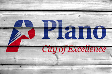 plano: Flag of Plano, Texas, USA, painted on old wood plank background