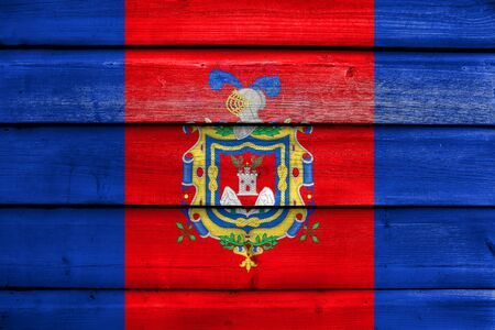 polity: Flag of Quito, Ecuador, painted on old wood plank background Stock Photo
