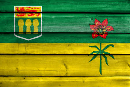 saskatchewan flag: Flag of Saskatchewan Province, Canada, painted on old wood plank background