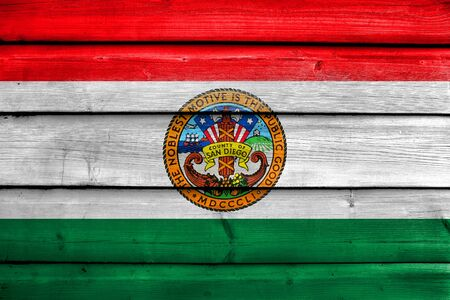 Flag of San Diego County, California, USA, painted on old wood plank background