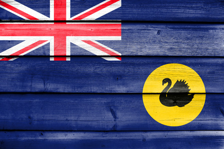 western state: Flag of Western Australia State, Australia, painted on old wood plank background