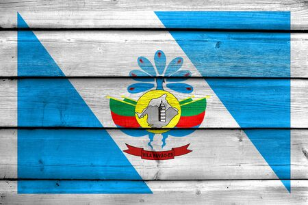 Flag of Vila Pavao, Espirito Santo State, Brazil, painted on old wood plank background