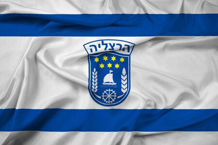 jewish community: Waving Flag of Herzliya City , Israel Stock Photo