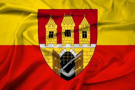 escutcheon: Waving Flag of Prague with Coat of Arms (Escutcheon only), Czechia Stock Photo