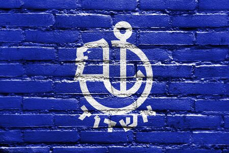 Flag of Ashdod, Israel, painted on brick wall Stock Photo
