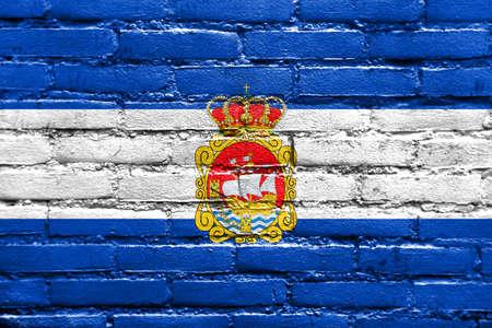 aviles: Flag of Aviles, Spain, painted on brick wall Stock Photo