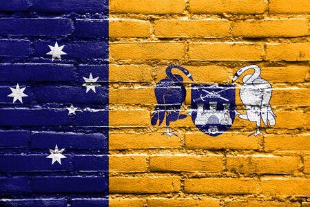 polity: Flag of Australian Capital Territory, Australia, painted on brick wall