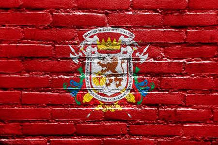 caracas: Flag of Caracas, Venezuela, painted on brick wall