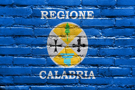 polity: Flag of Calabria, Italy, painted on brick wall Stock Photo