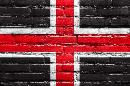 durham: Flag of Durham, England, UK, painted on brick wall