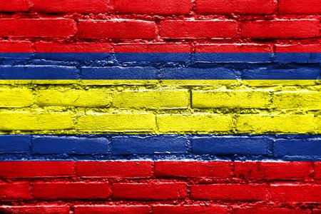 Flag of Loja, capital of Loja Province, Ecuador, painted on brick wall