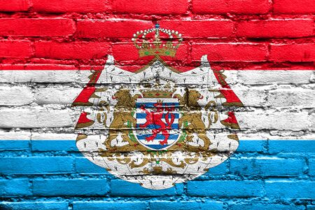 Flag of Luxembourg with Coat of Arms, painted on brick wall Stock Photo