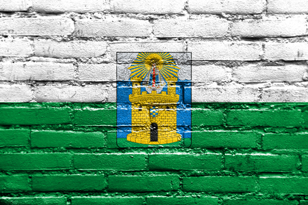 medellin: Flag of Medellin, Colombia, painted on brick wall