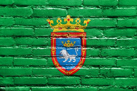 polity: Flag of Pamplona, Spain, painted on brick wall