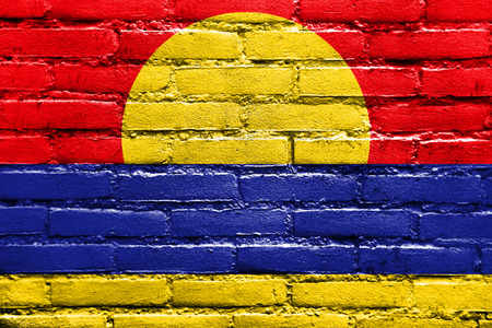 atoll: Flag of Palmyra Atoll (unofficial), painted on brick wall Stock Photo