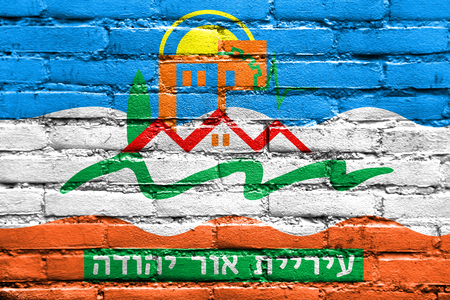 Flag of Or Yehuda, Israel, painted on brick wall