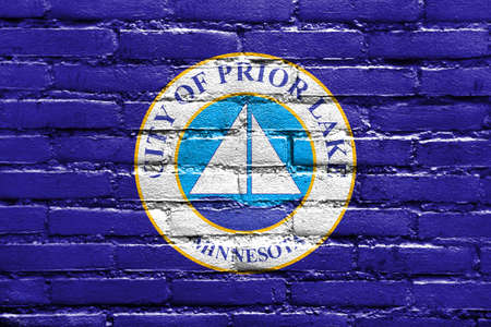 prior lake: Flag of Prior Lake, Minnesota, USA, painted on brick wall Stock Photo