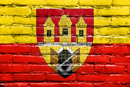 Flag of Prague with Coat of Arms (Escutcheon only), Czechia, painted on brick wall Stock Photo