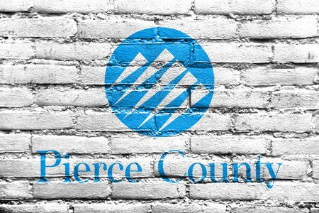 pierce: Flag of Pierce County, Washington, USA, painted on brick wall Stock Photo