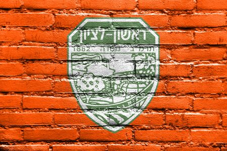 Flag of Rishon LeZion, Israel, painted on brick wall Stock Photo