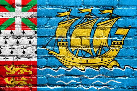 old flag: Flag of Saint Pierre and Miquelon (unofficial), painted on brick wall Stock Photo