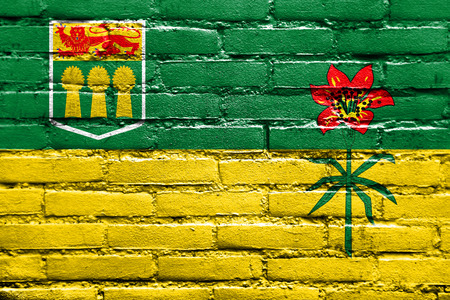 Flag of Saskatchewan Province, Canada, painted on brick wall Stock Photo