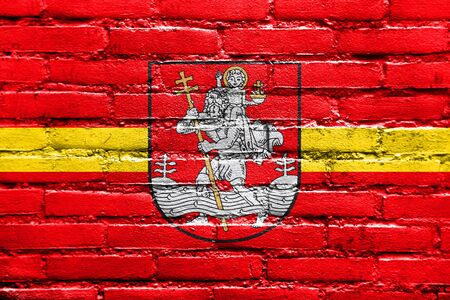 polity: Flag of Vilnius, Lithuania, painted on brick wall