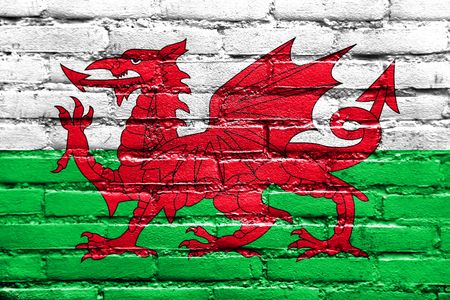 wales: Flag of Wales, UK, painted on brick wall