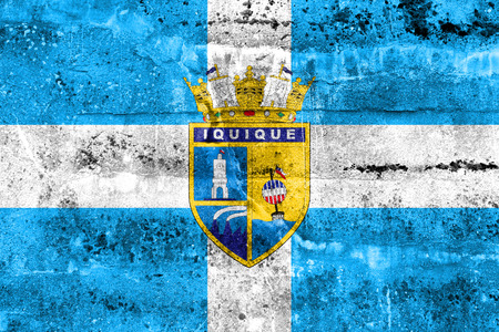 territory: Flag of Iquique, Chile, painted on dirty wall Stock Photo